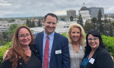 Partners Jasmine Hale and Nathan McGuire, with Marketing Director Sue Anderson and Client Relations Director and Administrator, Northern California Melina Drazich, at Leg Day 2019 on 4-8-19